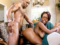 Busty ebony sucking huge cock and fucking doggystyle on sofa