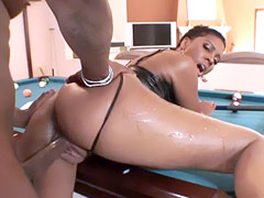 Ebony babe sucks big black dick and gets fucked on billiard table