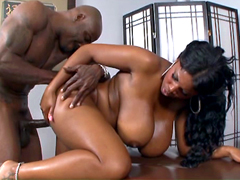 Huge titted black milf gets pussy drilled from behind