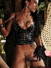 Sexy ebony shemale in fetish clothes..