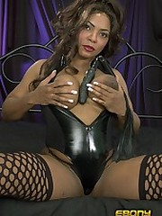 An insatiable black babe using toys to..