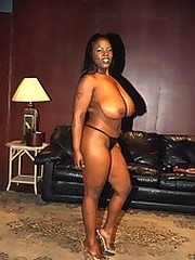 Busty black beauty poses for dirty..