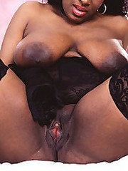 Chocolate lingerie model does a full spread
