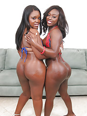Ebony MILF babes Janae and Samone posing alfresco showing big butts