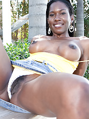 Black girl Lucia Brixton showing zaftig boobs and spreading sexy legs