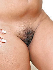 Busty black slut Paris exposes the brush sportive ass added to hairy cunt outdoor