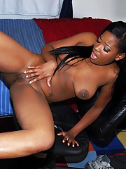 Big titted ebony girl Amber Stars strips together with rubs their way clit