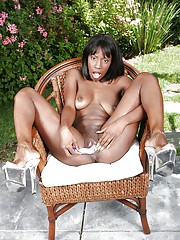 Chap-fallen ebony babe Lady Armani stripping and masturbating her slit open-air