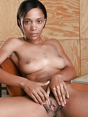 Sexy ebony babe taking deficient keep their way underclothes and spreading their way legs