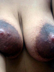African ebony whore with huge dark nipples