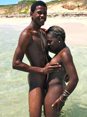 African couple having sex on rest on sea side