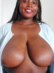 Busty ebony sister with very very huge jugs