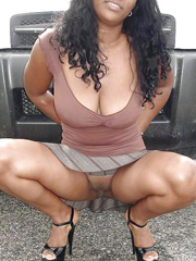 Busty fair-skinned mother shows off her huge natural tits near the car