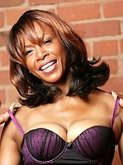 Busty ebony mature Semmie Desuora posing in classy miniskirt lingerie