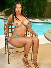 Impassioned black mom showing off ripsnorting boobs coupled with booty at one's fingertips the pool