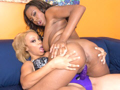 A hot ebony whore riding her girlfriends strap on cock...