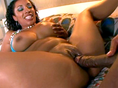 This petite delicious black milf has a pair of big tits and she gets her ebony pussy stretched by..