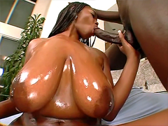 Wet oiled ebony slut Delotta Brown deep slurps fat man tool
