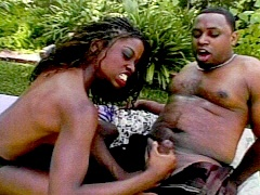 Feisty black hottie giving a handjob..