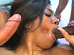 Black babe boned by two cocks in this..