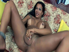 Lusty Latina shemale Cinthia stuffed with a dildo