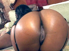 Camrie Foxx bends over in front of him..