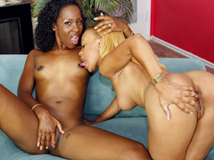 Two ebony lesbians getting each other off in hardcore action