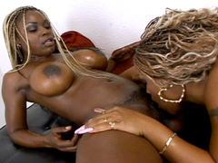 Busty black girls licking pussy and using sex toys on each other