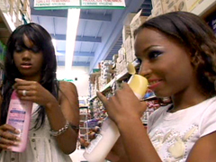 These two young black babes catch each others' eye as they are shopping in the supermarket. You..