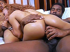 As Melrose Foxxx kneels in front of them, they whip out their big black boners and place them in her very..