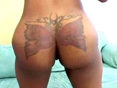 Hot african whore with tattoo on ass..