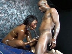 Ebony babe gives hot blowjob to big..