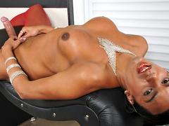 Hot tranny strokes her big cock