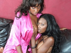 Long haired ebony hotties using a strap on to have hot..