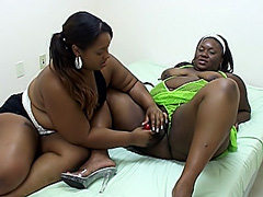 BBW lesbos use a strap-on dildo to..