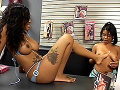 Ebony lesbian girls in a sex-shop...