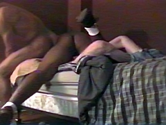 A submissive white guy is tied to the bed and promptly railed by two black men. The other guy shows no..