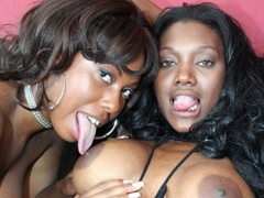 Two curvy ebony dykes getting it on in hardcore style...