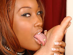 Two pretty ebony girls in some foot licking lesbian fun...