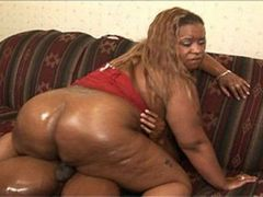 Fat ebony tramp rides a hard cock