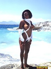 An ebony nympho with a great rack posing at the beach