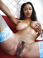 Dark-skinned girl with huge jugs Tyra Moore flowing say no to hairy twat