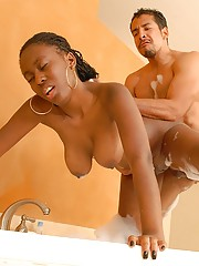 Black girl with massive juggs gets full-bodied and fucked in the bathroom