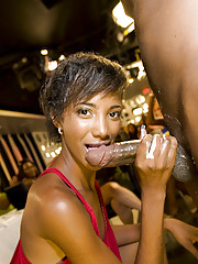 Cute ebony tot sucks a stripper's weasel words and gets a cumshot at the CFNM party