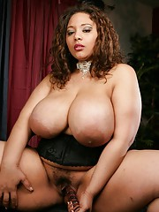 Ebony babe Lady Sprint showcasing her paunchiness boobs together with toying her cunt