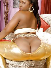 Ebony battle-axe Morgan Cummings posing in goldy leggings and bringing off with a huge dildo