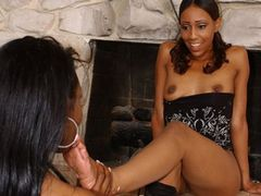 Black lesbian babes using a double dildo and feet to get off
