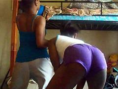 Two drunken black coeds dancing in hostel